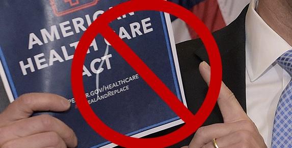 A close-up of Paul Ryan's hands holding up a copy of the American Health Care Act with a red 'NO' mark (a circle with a line through it) superimposed on top